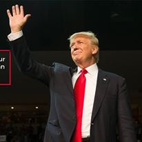 Donald Trump waves to his supporters.