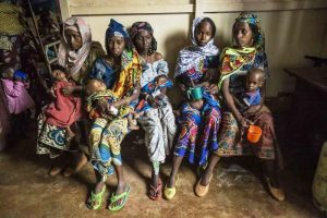 refugee-mothers-wait-with-their-children-for-milk-distribution-in-the-crowded-batouri-nutrition-center-photo-credit-unhcr