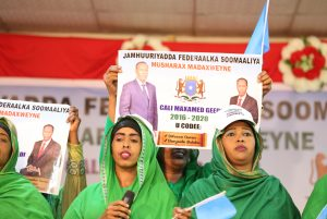 Former Somalia Prime Minister Ali Mohameed Gedi's supporters waving banners when launched his presidential bid at City Palace Hotel in Mogadishu, Somalia in this picture taken on December 17, 2016. He seeks to turnaround the war-torn country if given the opportunity. More than 20 candidates are vying for the presidency. Photo/Billy Mutai